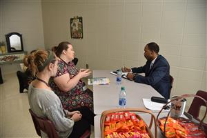 Dr. Gary meeting with teachers